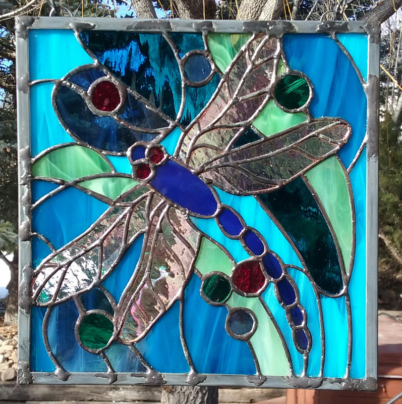 geometric stained glass dragon fly